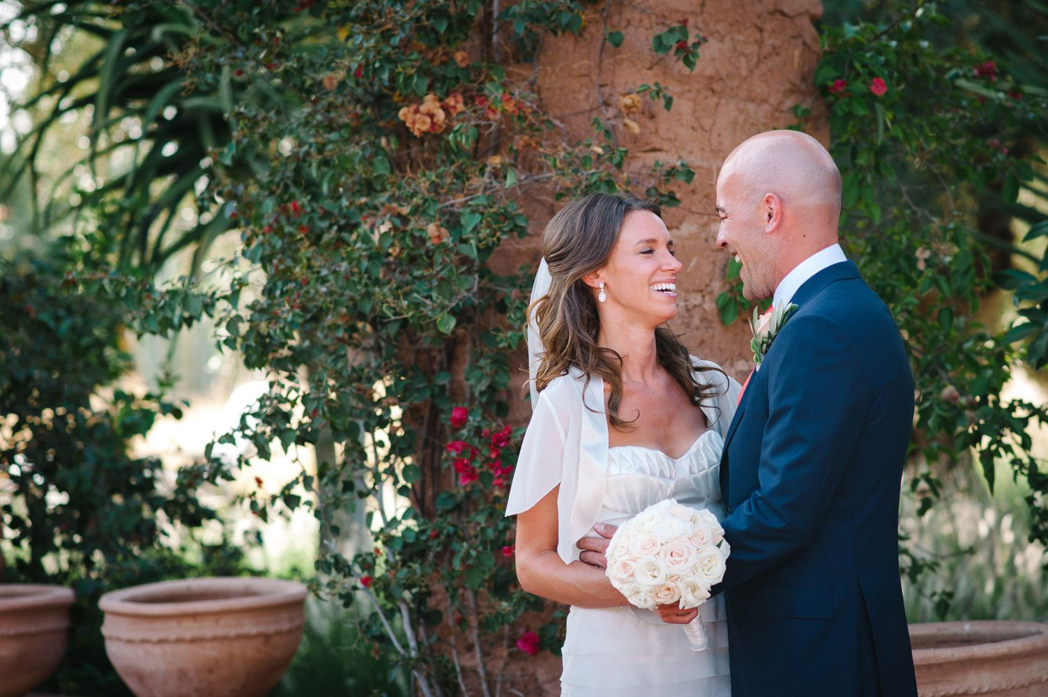 bride and groom laugh at beldi country club