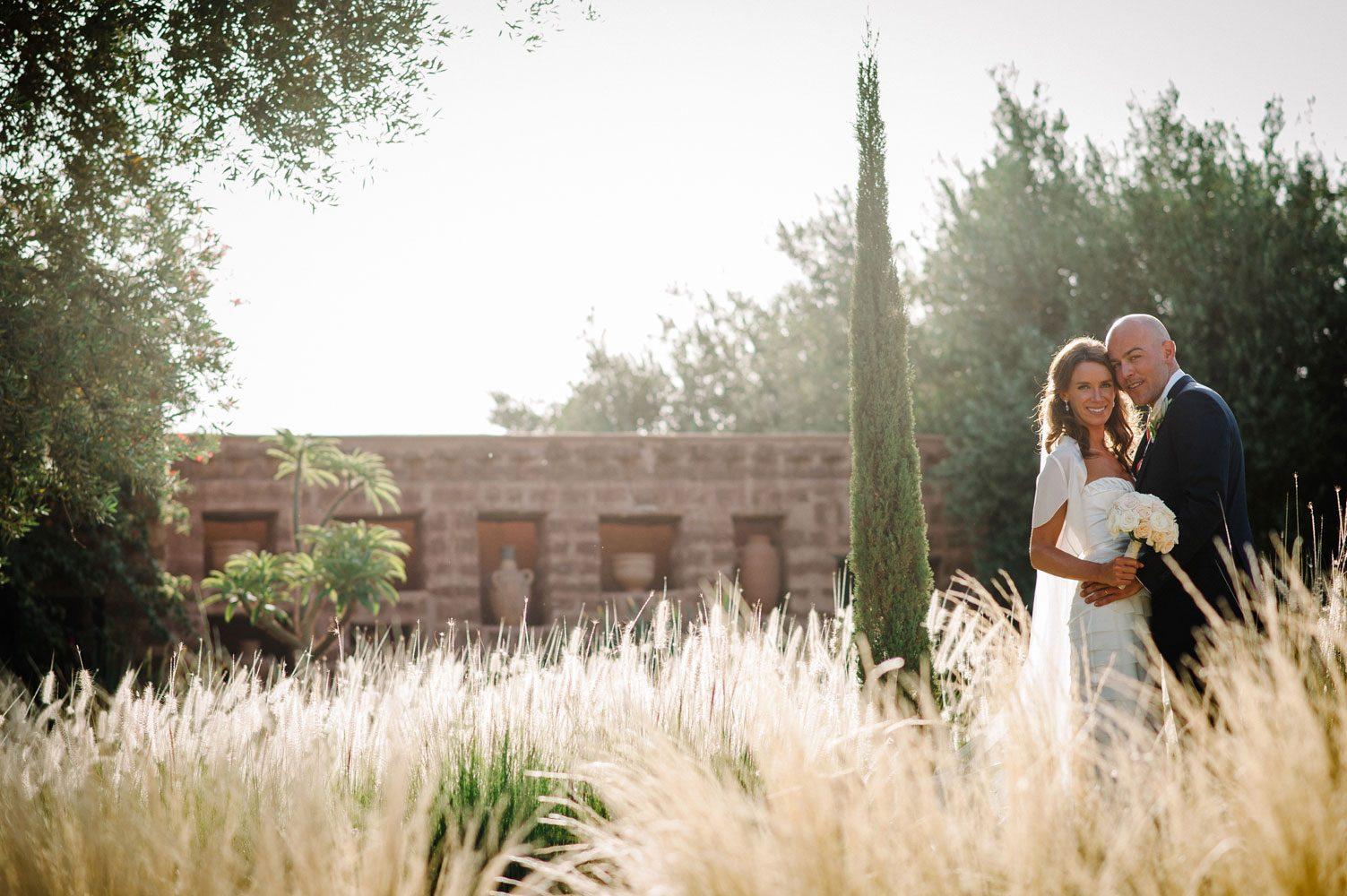 bride and groom in garden of beldi country club