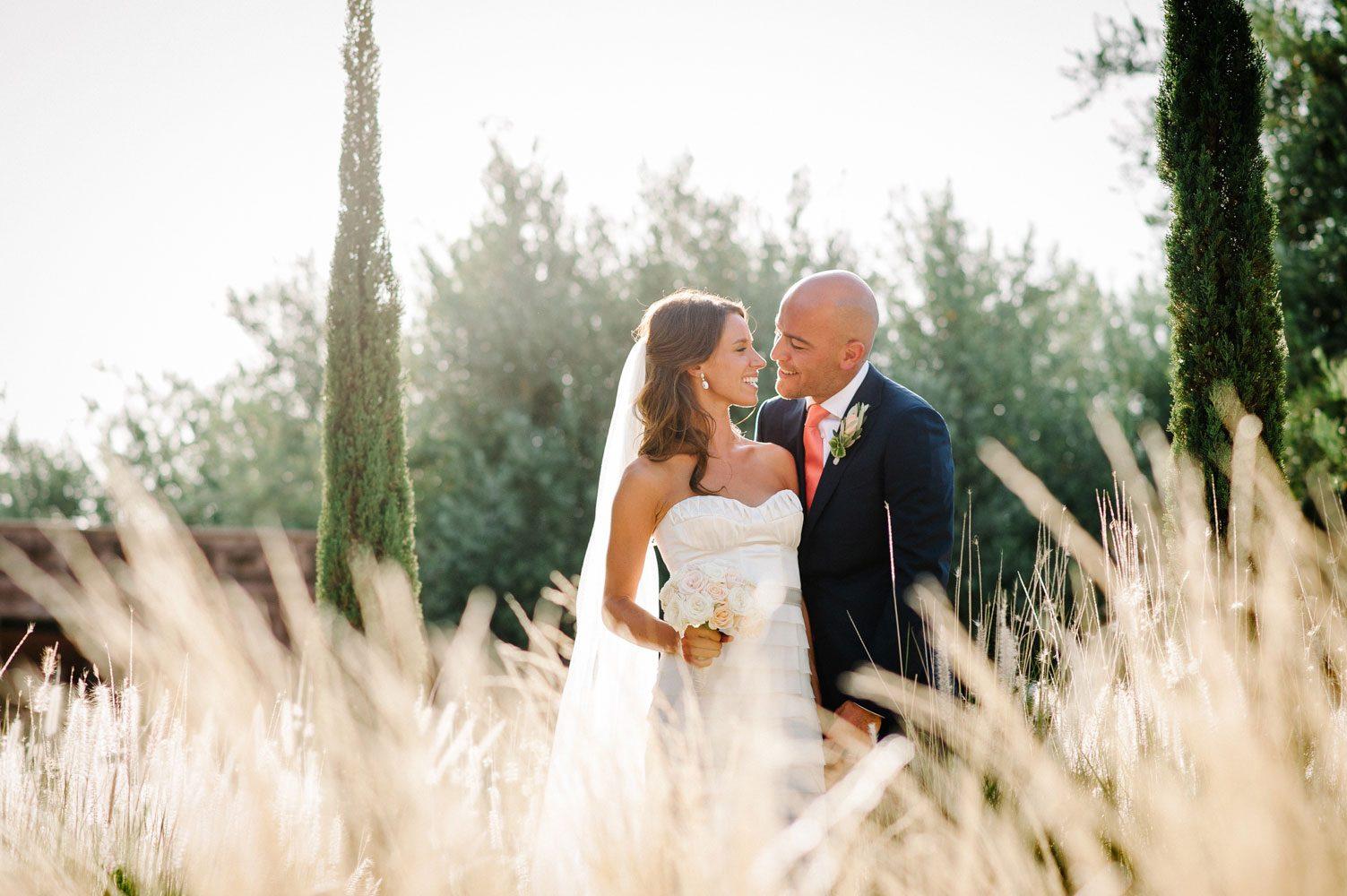bride and groom pose in beldi country club garden wedding