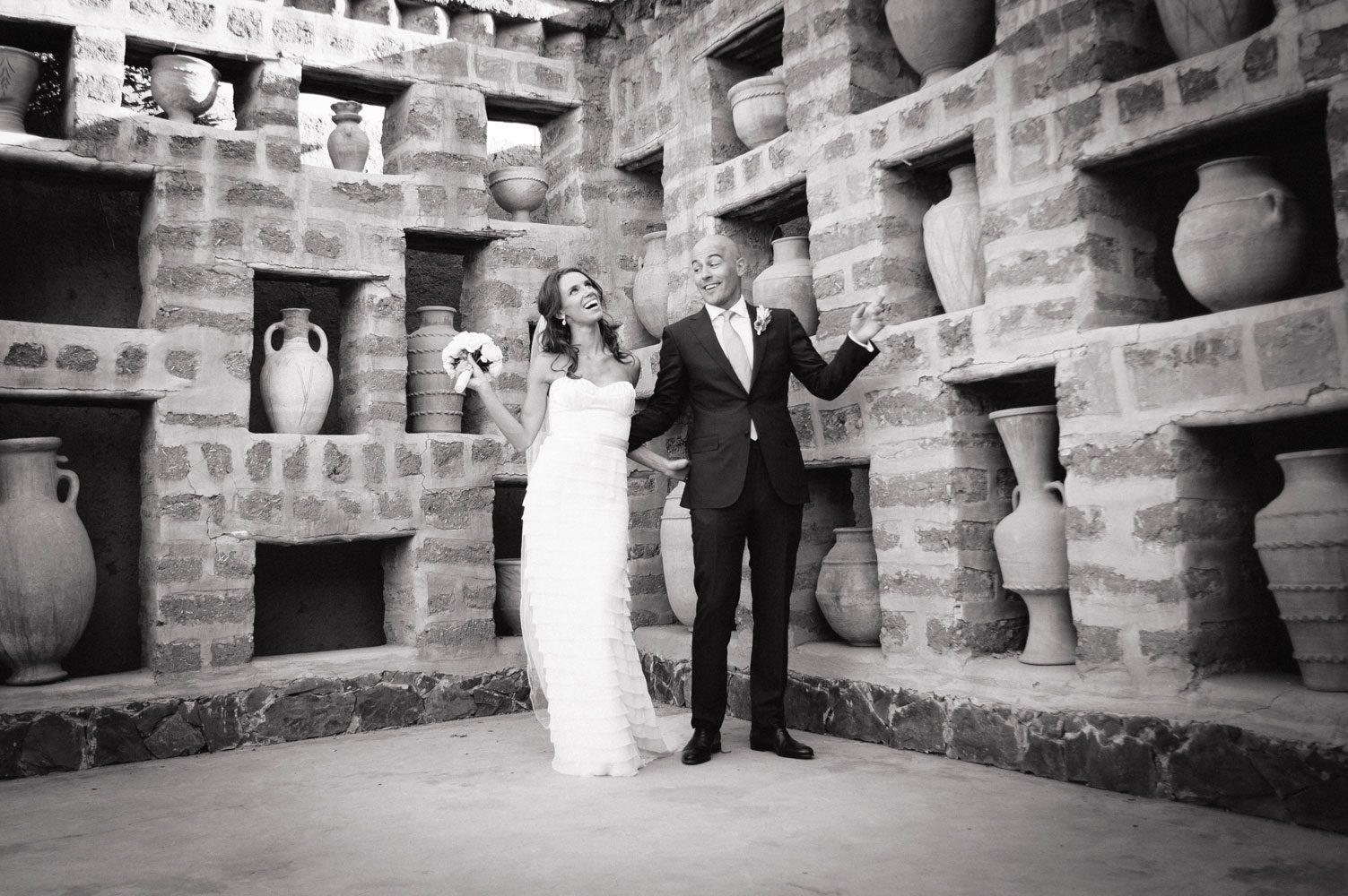 bride and groom pose in marrakech