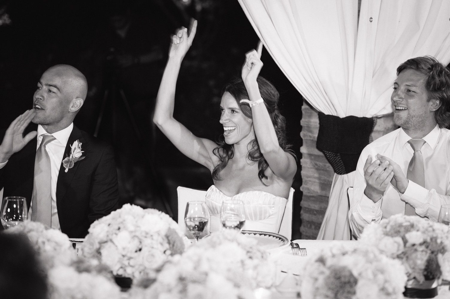 bride cheers during speeches