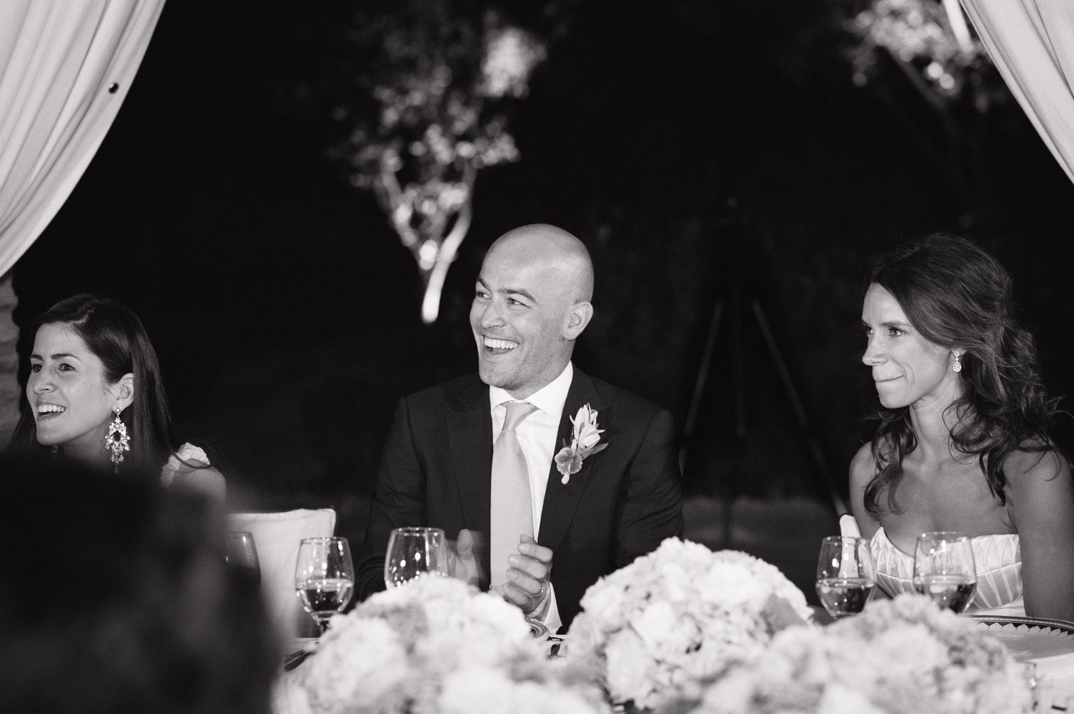 groom laughing at wedding reception