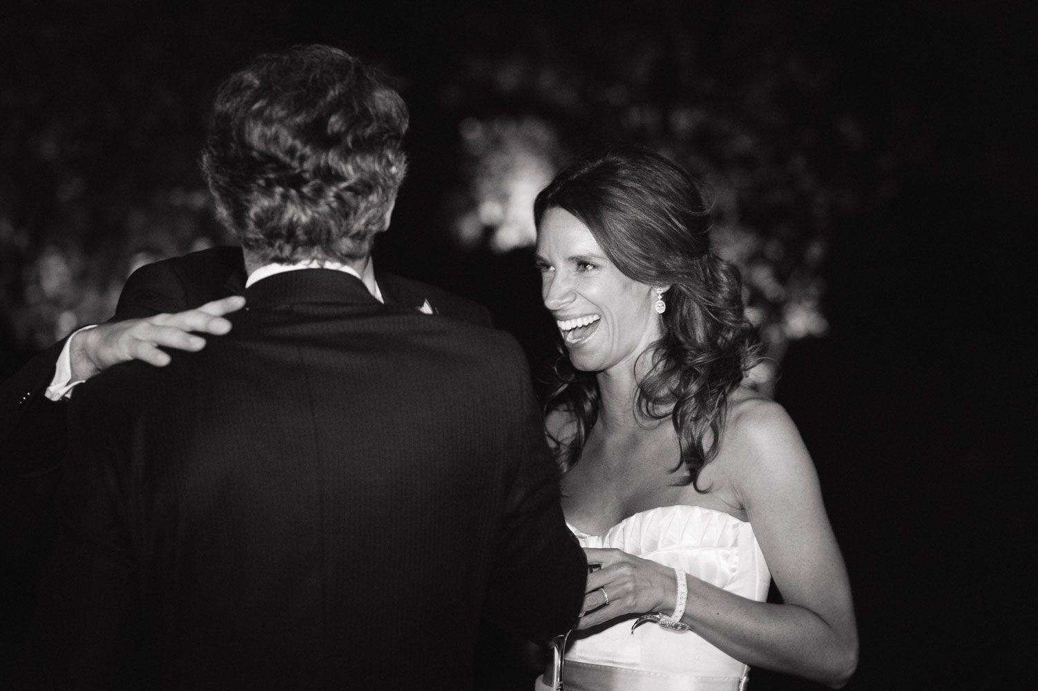 stylish bride laughing at wedding