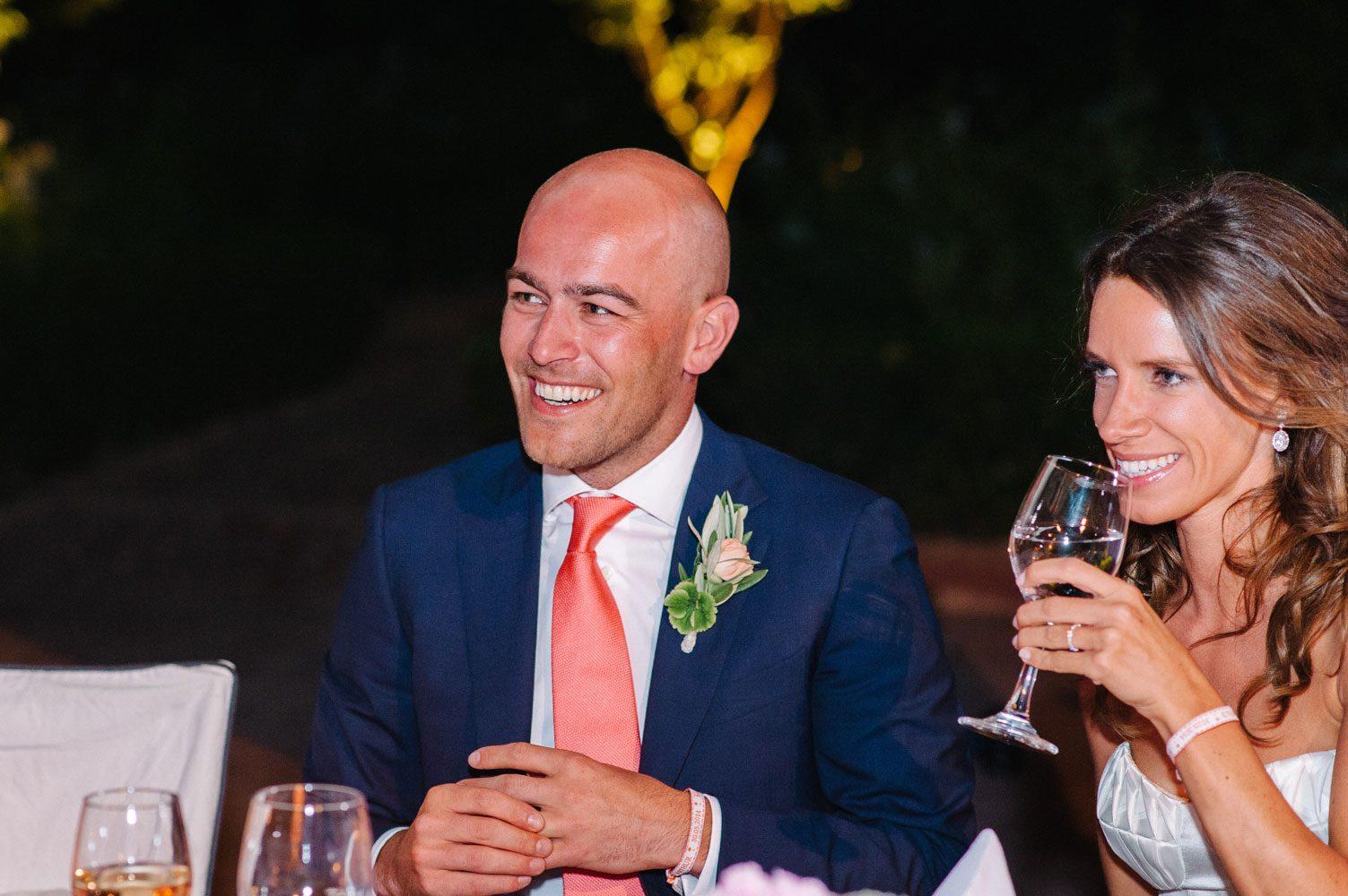 groom wearing bespoke suit at wedding