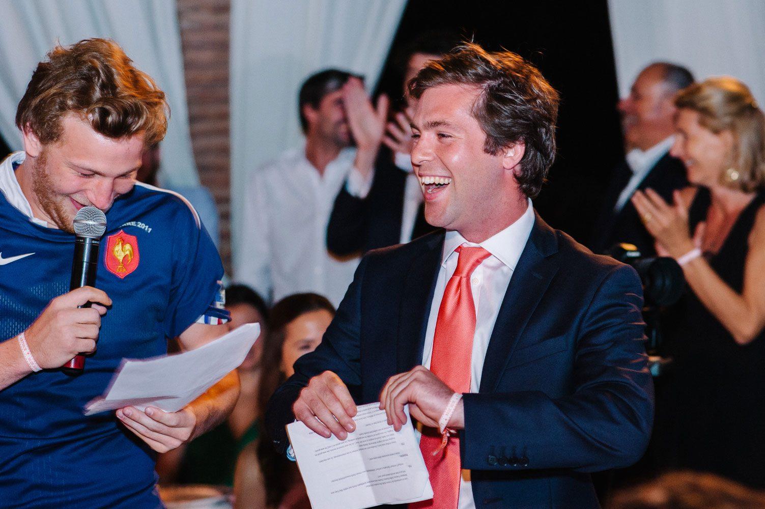 guests laugh whilst making fun wedding speech