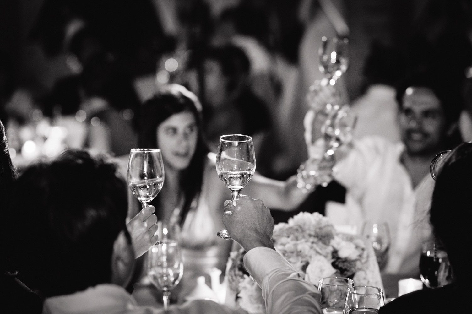 glasses raised at beldi wedding