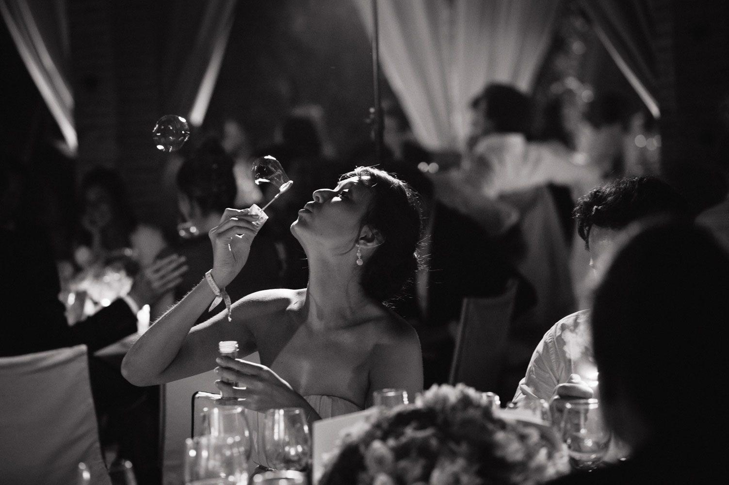 guests blow bubbles at wedding