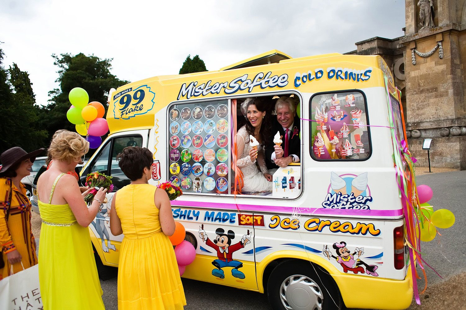 bride and father sell ice cream to bridesmaids
