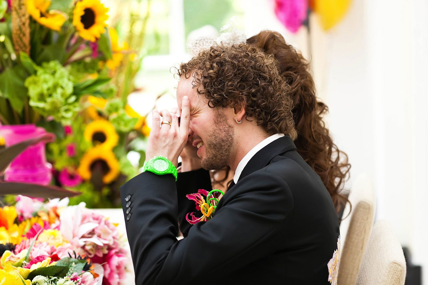 groom takes photos with wedding camera