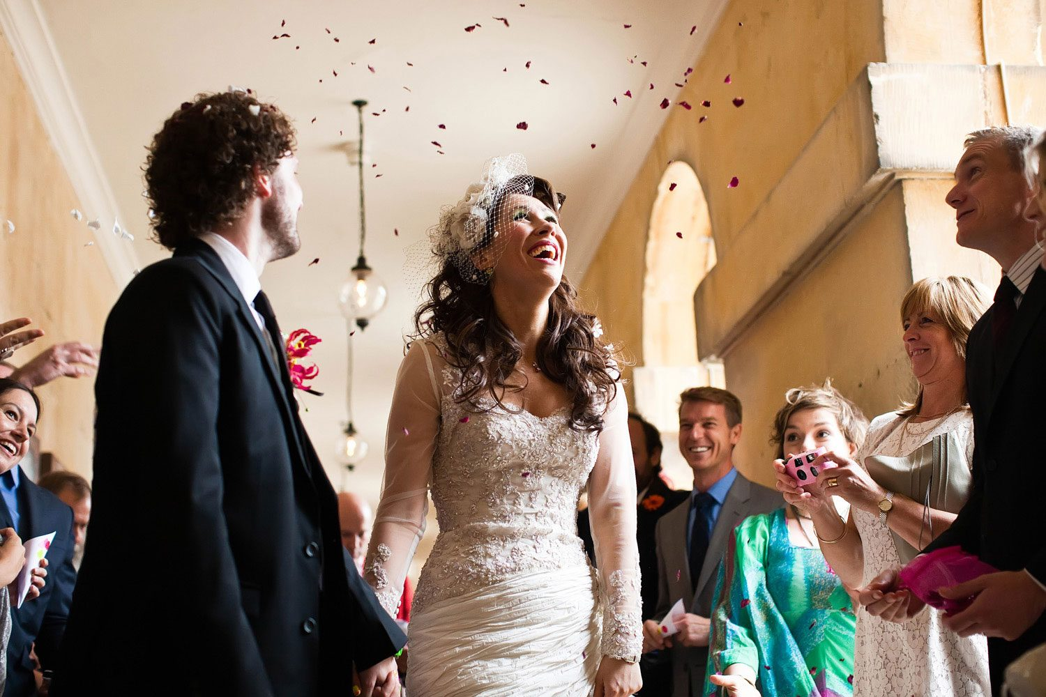 bride watches rose petals fall for weddings