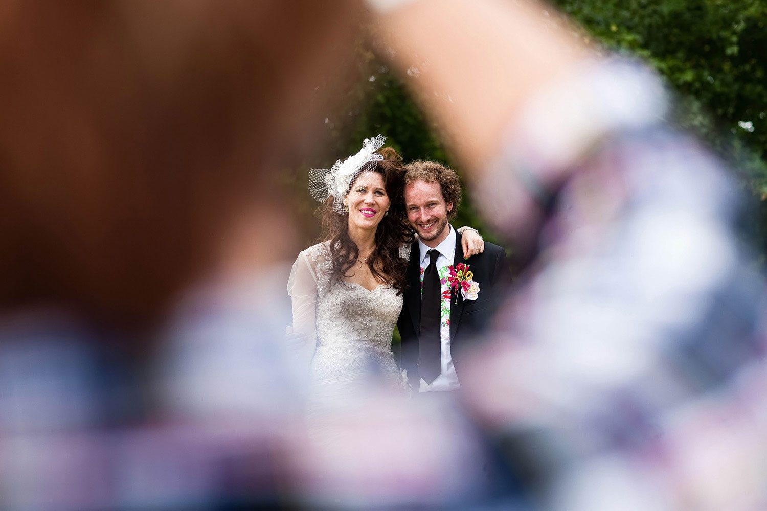 bride and groom pose for london wedding photographer