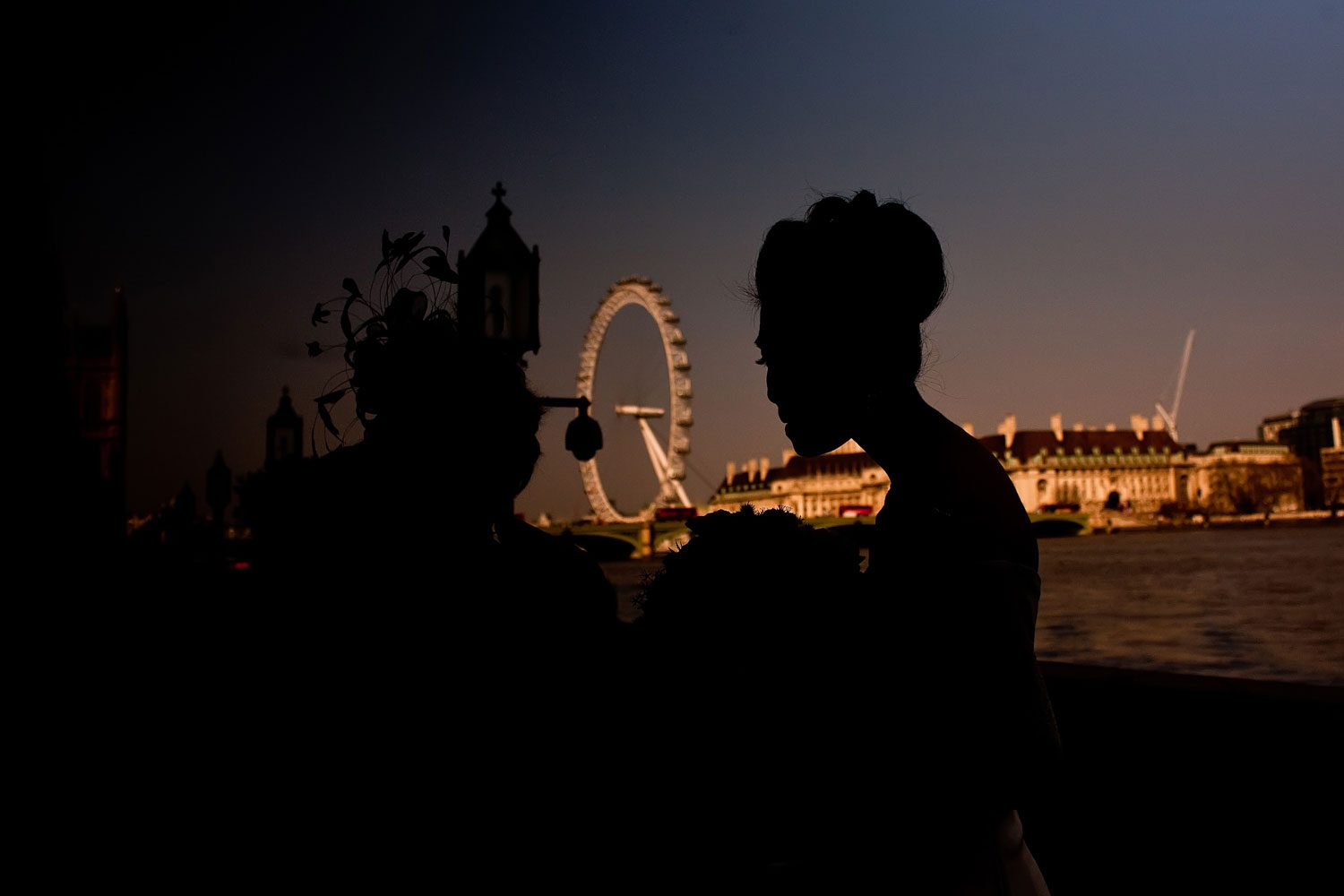 bride stands in front of london eye