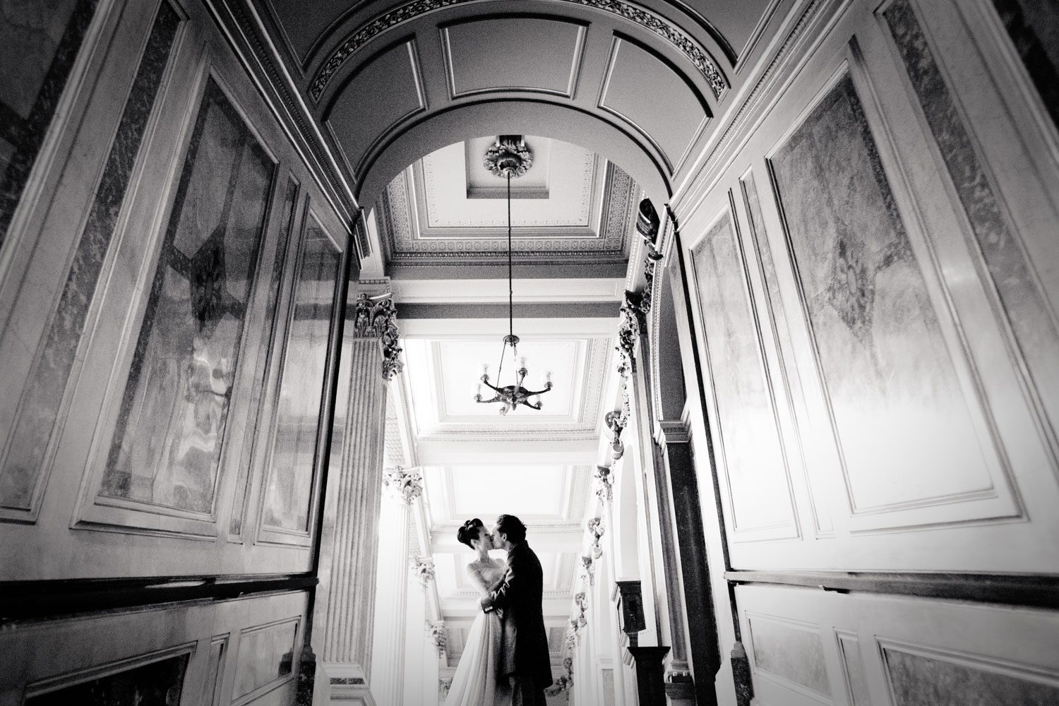 bride and groom kiss at reform club wedding