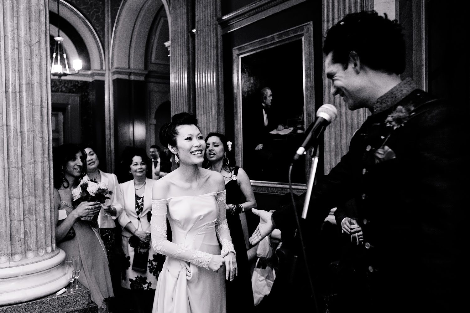 bride watches groom during speech