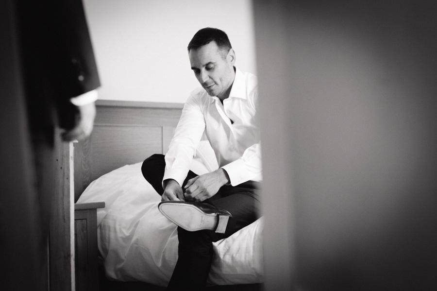 bridegroom getting ready notley abbey wedding