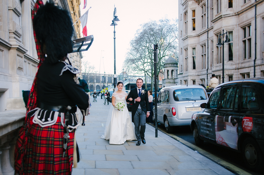 bride and groom arrive at corinthia hotel london
