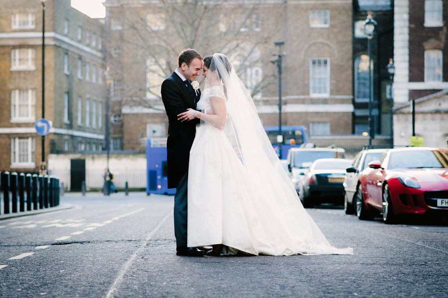 bride and groom outside corinthia hotel london