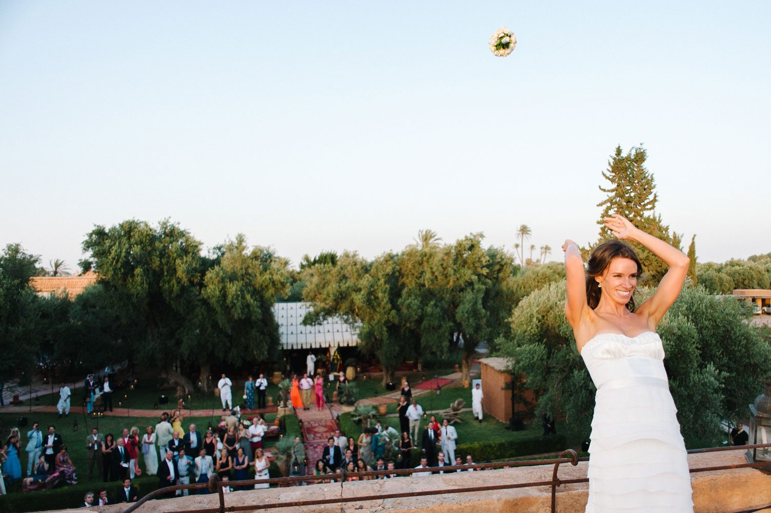 bride throws bouquet in marrakech