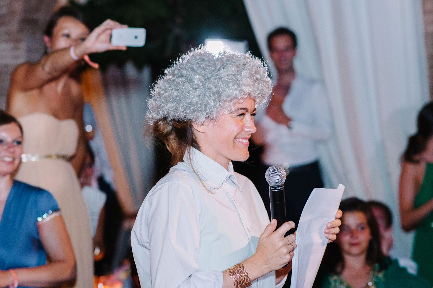 guest wears wig for wedding speech