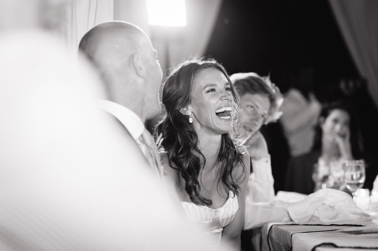 bride laughs at wedding reception