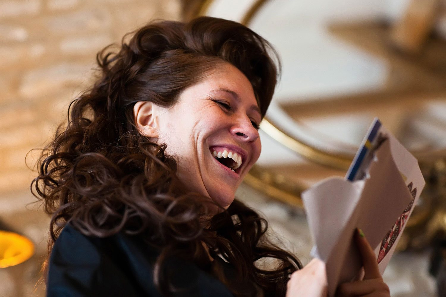 bride laughing at card from groom