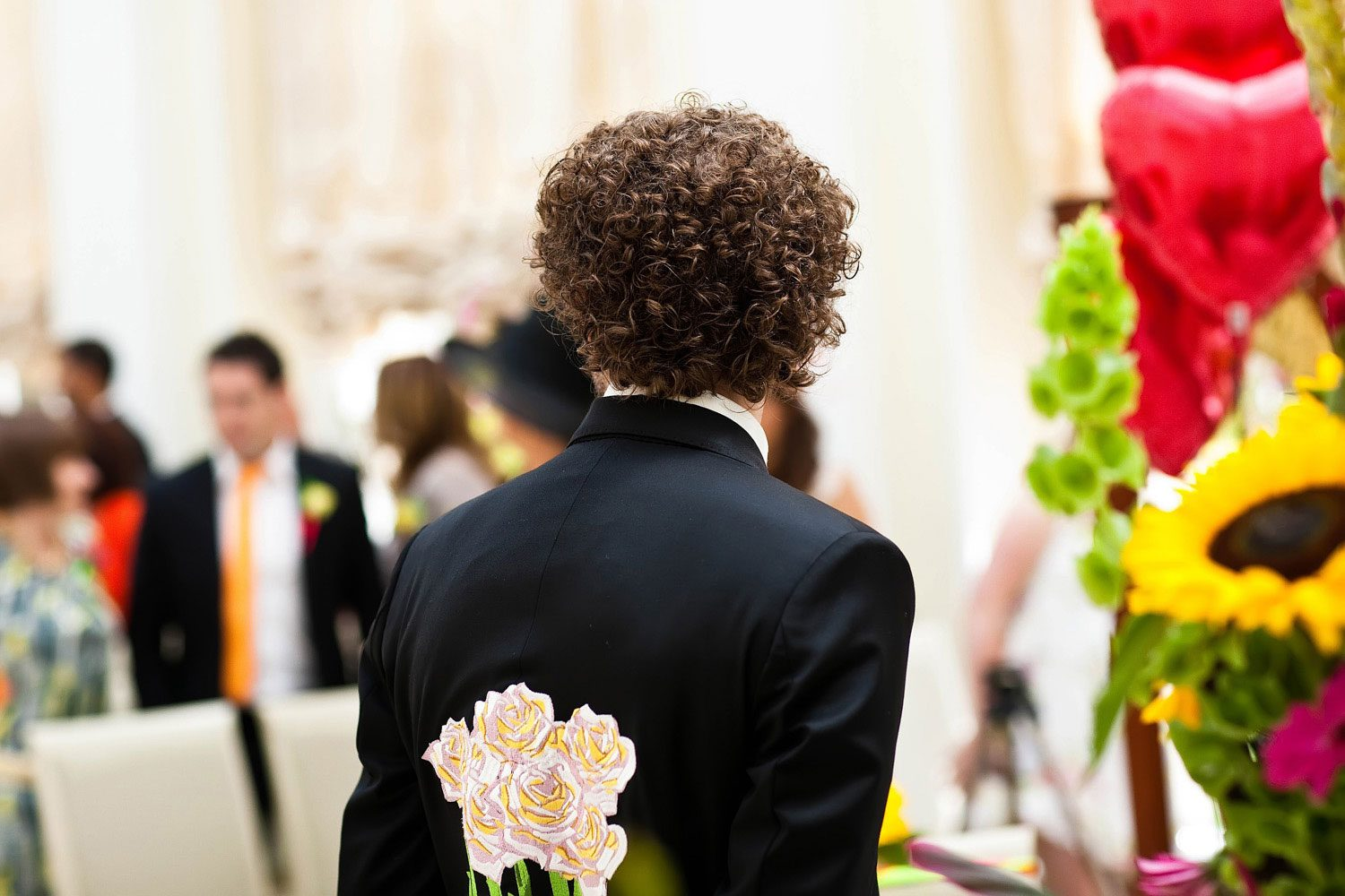 groom waits in bespoke designed jacket