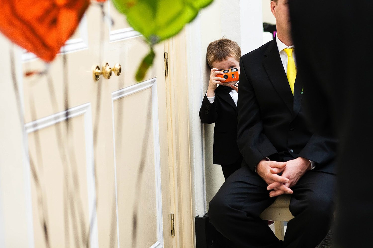 little boys takes picture at wedding