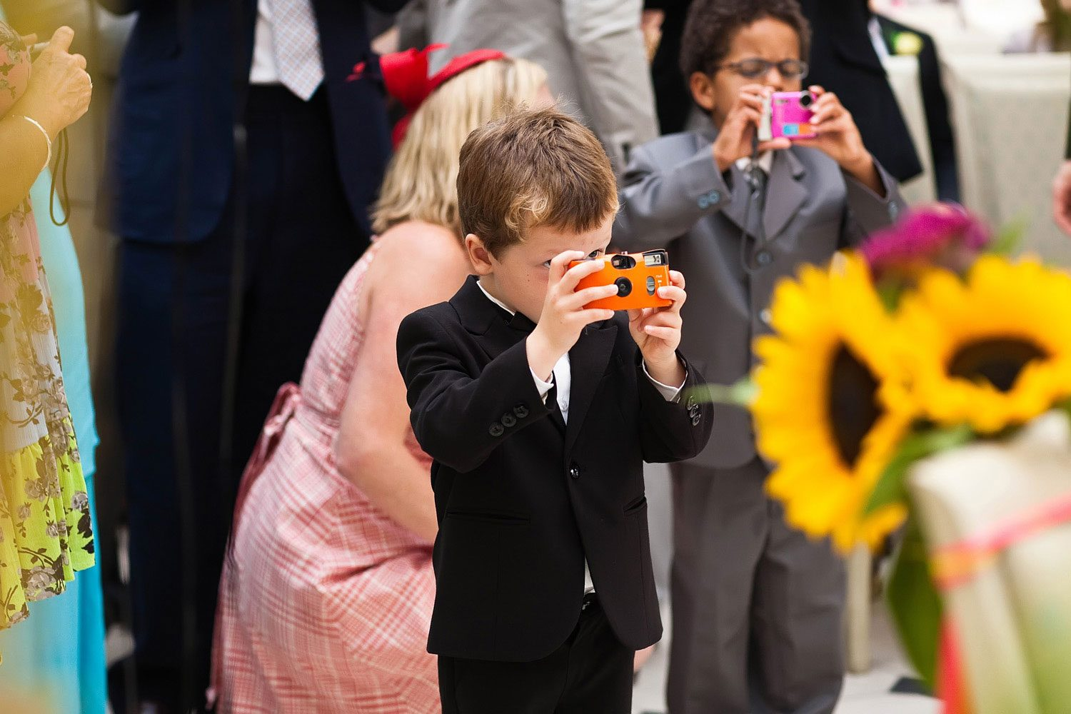 little boy takes photo at london wedding