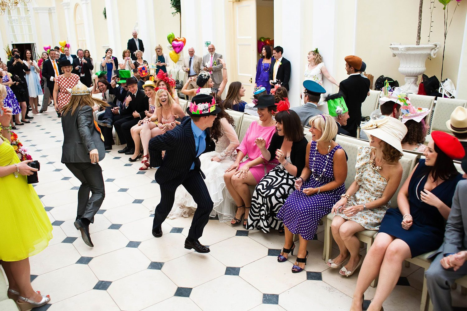 guests play musical chairs at wedding