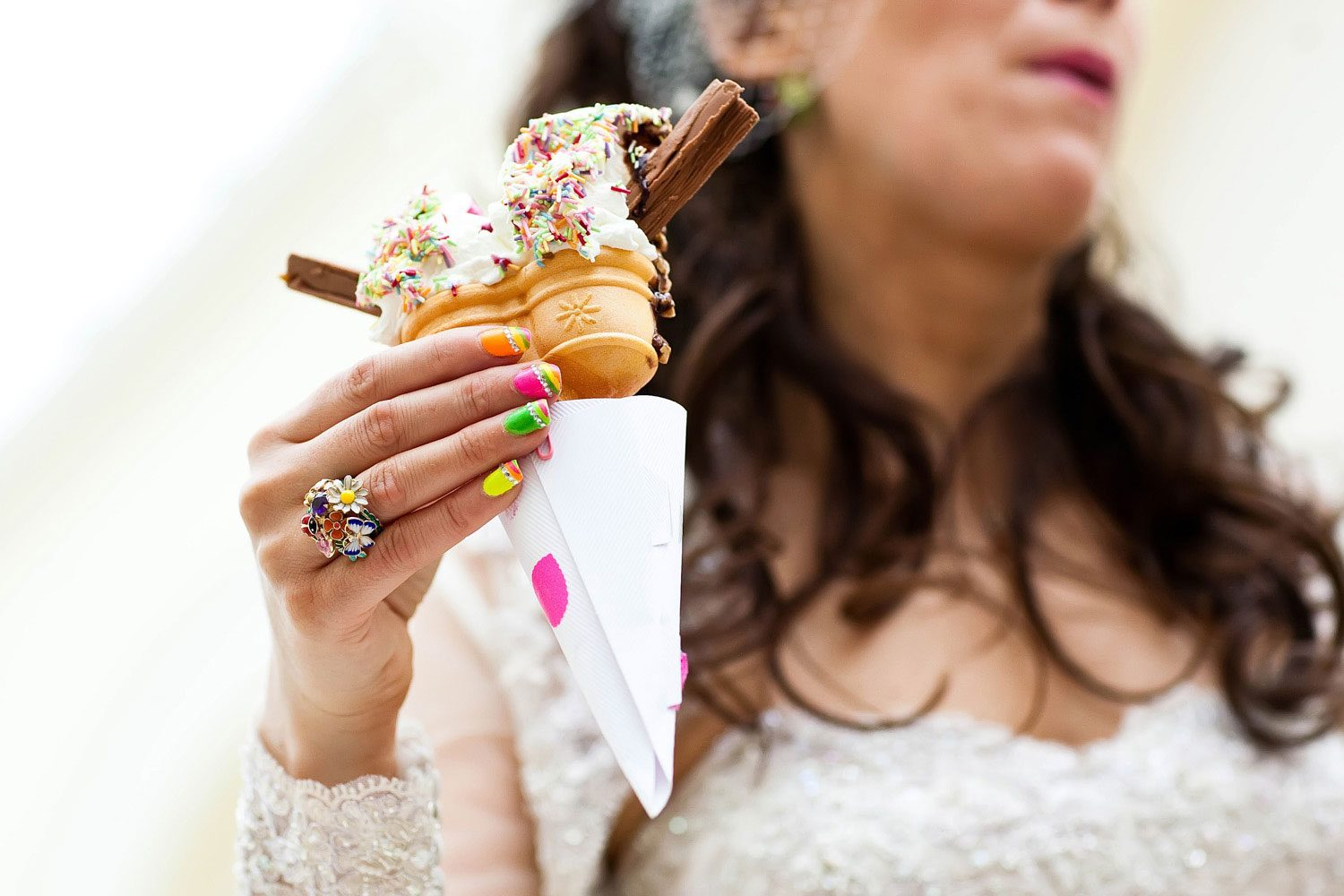 bride holds ice cream at wedding