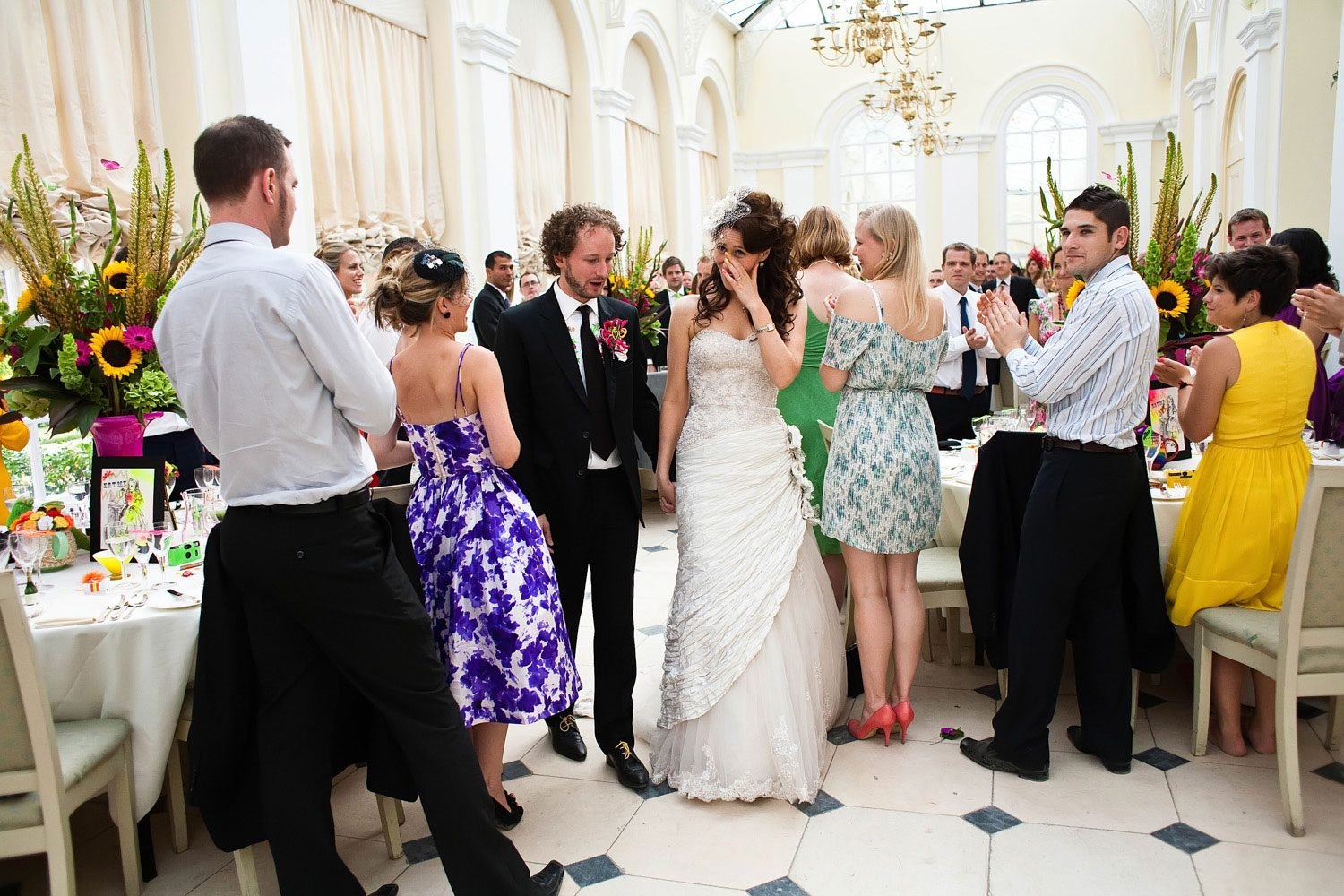 bride cries whilst entering wedding reception
