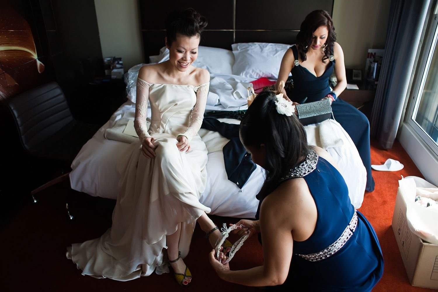 bride puts on wedding garter