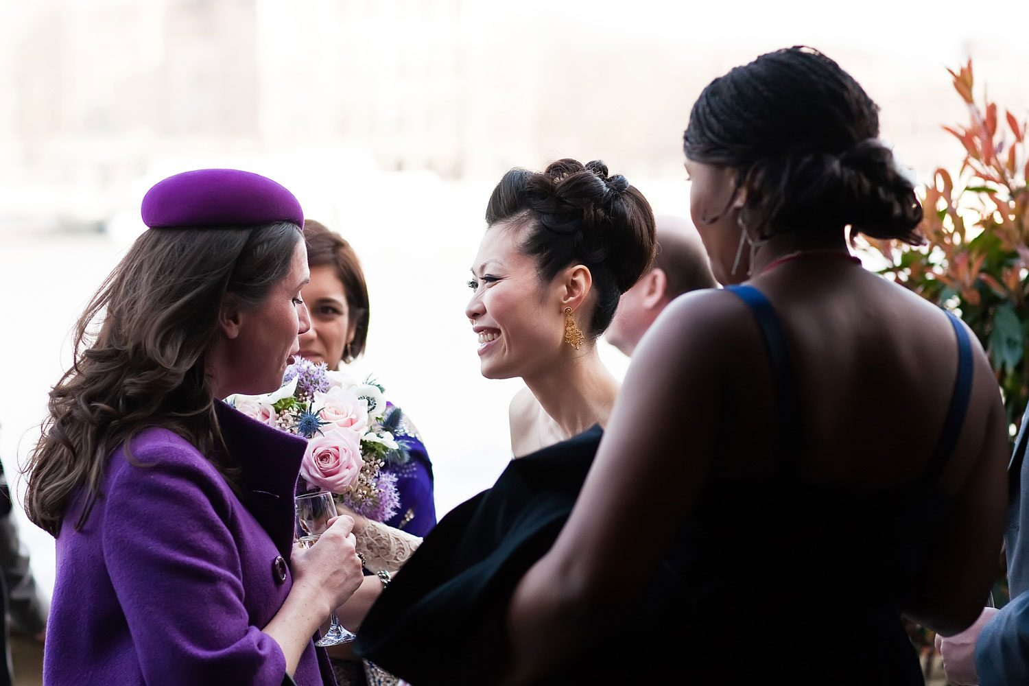 bride smiles with guests at house of lords