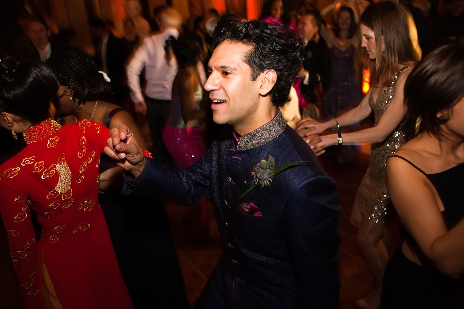 groom dancing at reform club wedding